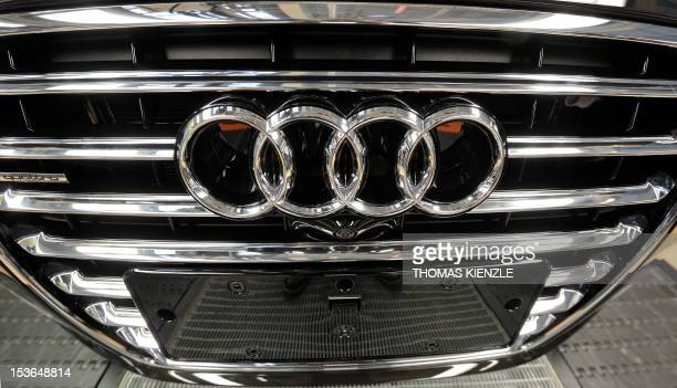 The logo of German luxury car maker Audi can be seen on a radiator grill of an Audi A8 car at the assembly line of the Audi plant in Neckarsulm...