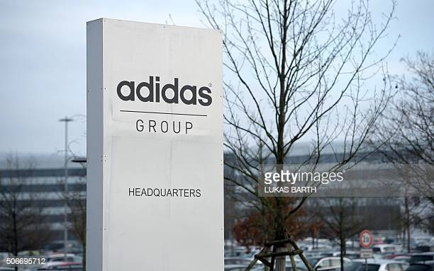 The logo of German sport brand Adidas is pictured at a stand in front of the Adidas Headquarters in Herzogenaurach on January 25 2016 / AFP / LUKAS...