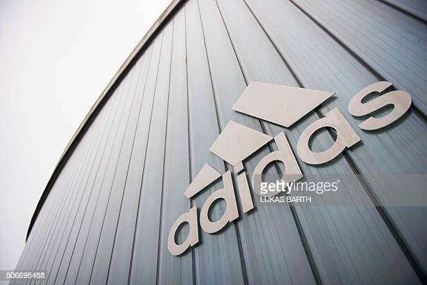 The logo of German sport brand Adidas is pictured on an Outlet Center in Herzogenaurach on January 25 2016 / AFP / LUKAS BARTH