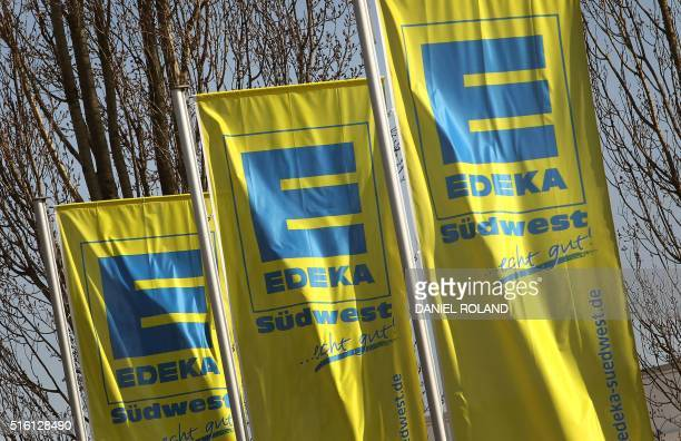 The logo of German supermarket chain EDEKA is pictured on flags in Heddesheim western Germany on March 17 2016 German Vice Chancellor Economy and...