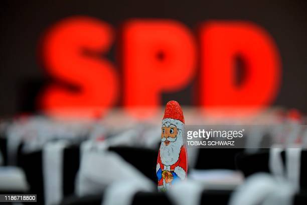 The logo of Germany's social democratic SPD party can be seen behind a chocolate Santa Claus at the venue of the party's congress in Berlin on...