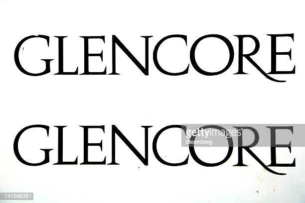 The logo of Glencore International Plc is displayed outside the company's headquarters in Baar, Switzerland, on Monday, March 19, 2012. Glencore...