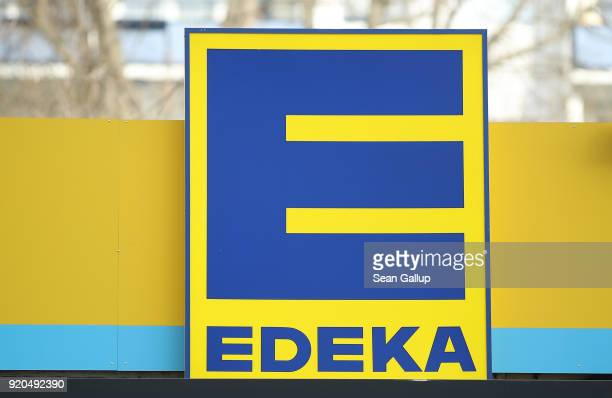The logo of grocery store of German chain Edeka stands on one of its stores on February 19 2018 in Berlin Germany According to media reports...
