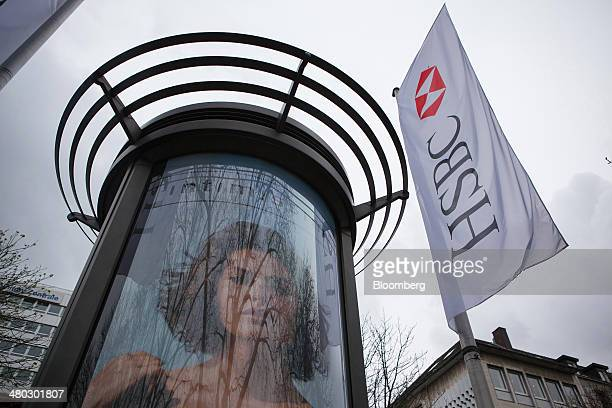The logo of HSBC Holdings Plc sits on a banner in Dusseldorf Germany on Saturday March 22 2014 Germany is underpinning a euroregion recovery that's...