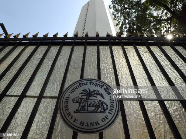 The logo of India's central bank the Reserve Bank of India is pictured on the gate of the bank in Mumbai on November 9 2016 Indian Prime Minister...