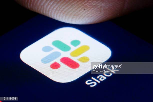 The logo of Instant Messaging Service Slack is shown on the display of a smartphone on April 22, 2020 in Berlin, Germany.