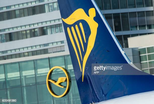 The logo of Irish lowcost airline Ryanair can be seen on a plane standing at the airport in Frankfurt am Main western Germany as in background can be...