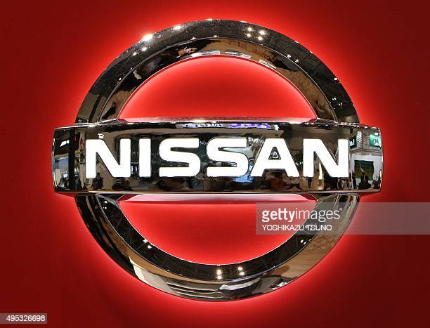 The logo of Japanese auto giant Nissan Motor is seen at the Tokyo Motor Show on November 2 2015 Nissan boosted its fullyear forecasts citing new...