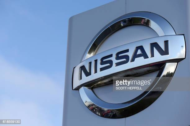 The logo of Japanese car giant Nissan stands in the forecourt of a Nissan car dealership in Sunderland north east England on October 25 2016 Japanese...