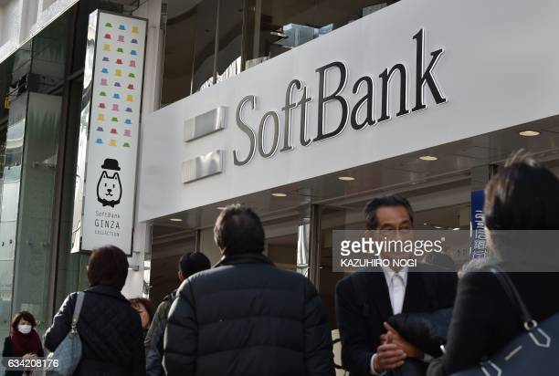 The logo of Japanese mobile provider SoftBank is displayed at an entrance of a shop in Tokyo's shopping district Ginza on February 8 2017 SoftBank...