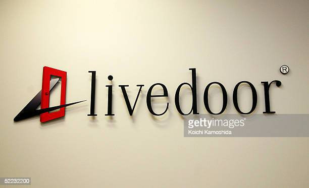The logo of Japanese software distributor Livedoor Co is seen at company headquarters February 23 2005 in Tokyo Japan Livedoor has raised its stake...