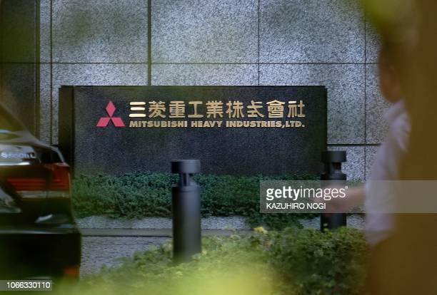The logo of Japan's Mitsubishi Heavy Industries Ltd. Is displayed at an entrance of the company's headquarters in Tokyo on November 29, 2018. - South...
