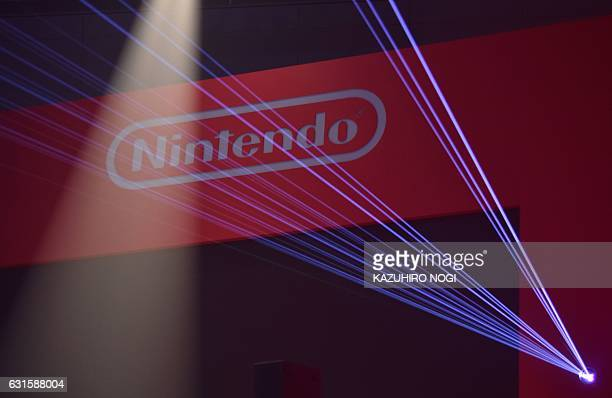 The logo of Japan's Nintendo Co is displayed at a presentation in Tokyo on January 13 2017 Nintendo on January 13 unveiled its new Switch game...