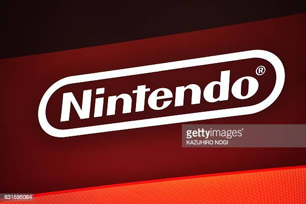 The logo of Japan's Nintendo Co. Is displayed at a presentation in Tokyo on January 13, 2017. Nintendo on January 13 unveiled its new Switch game...