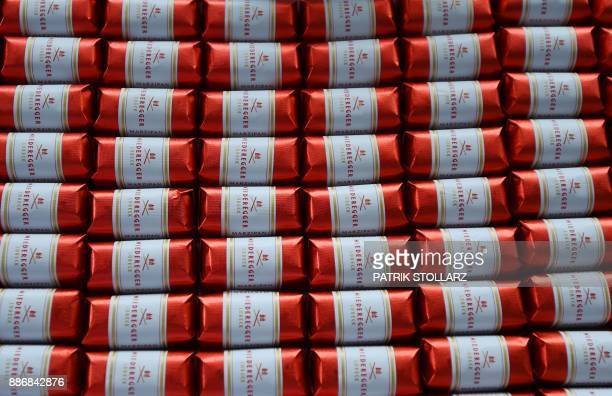 The logo of JG Niederegger is seen on the package of wrapped dark chocolate marzipan confectionary at the headquarters of the traditional...