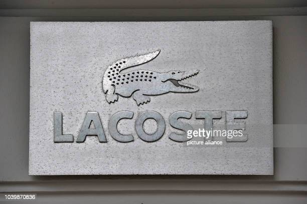 5349e0a572e8 The logo of Lacoste can be seen in Berlin Germany 13 June 2016 PHOTO PAUL  ZINKEN