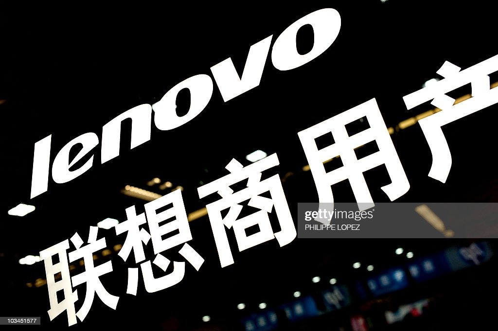 The logo of Lenovo is displayed at a com : News Photo