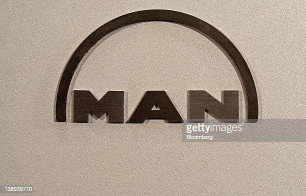 The logo of MAN SE is displayed during a news conference in Munich Germany on Tuesday Feb 14 2012 MAN SE the German truckmaker controlled by car...