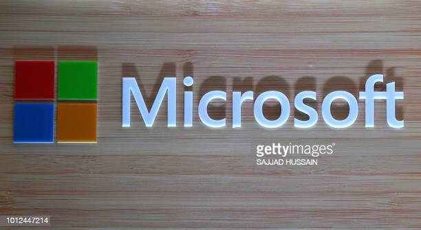 The logo of Microsoft is pictured during the launch of Surface Book 2 and Surface Laptop at a promotional event in New Delhi on August 7 2018