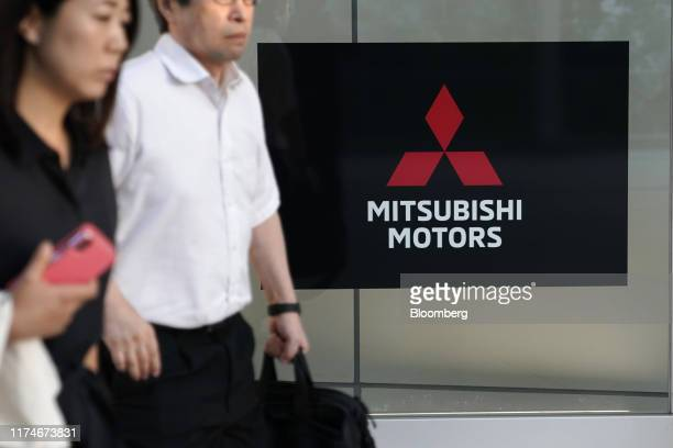 The logo of Mitsubishi Motors Corp is displayed during a news conference at the company's headquarters in Tokyo, Japan, on Wednesday, Oct. 9, 2019....