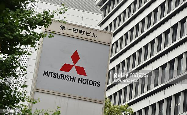 The logo of Mitsubishi Motors is displayed in front of the company's head office in Tokyo on June 22 2016 Mitsubishi Motors expects a net loss of 139...