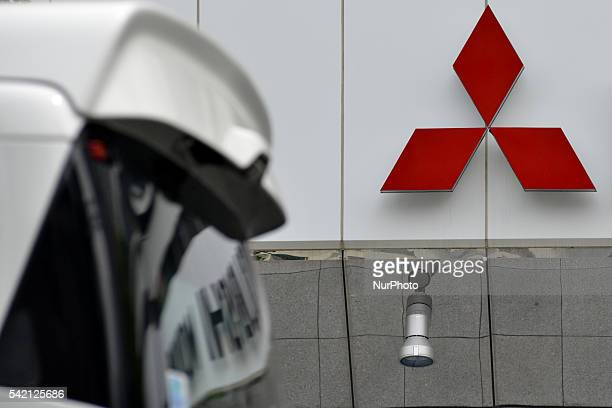 The logo of Mitsubishi Motors is displayed in front of the company's head office in Tokyo, Japan, 22 June 2016. The Japanese government said Tuesday...