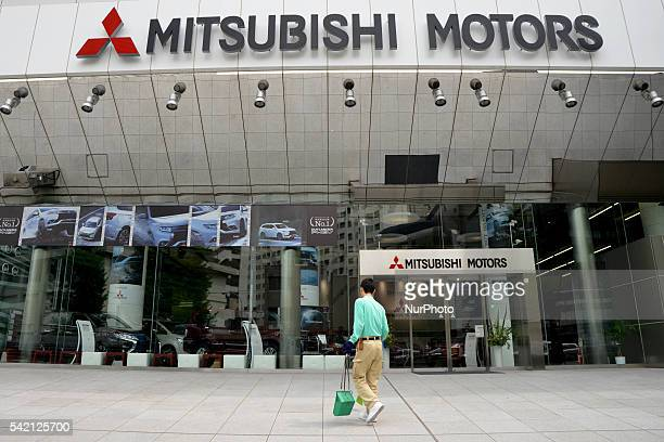 The logo of Mitsubishi Motors is displayed in front of the company's head office in Tokyo Japan 22 June 2016 The Japanese government said Tuesday...