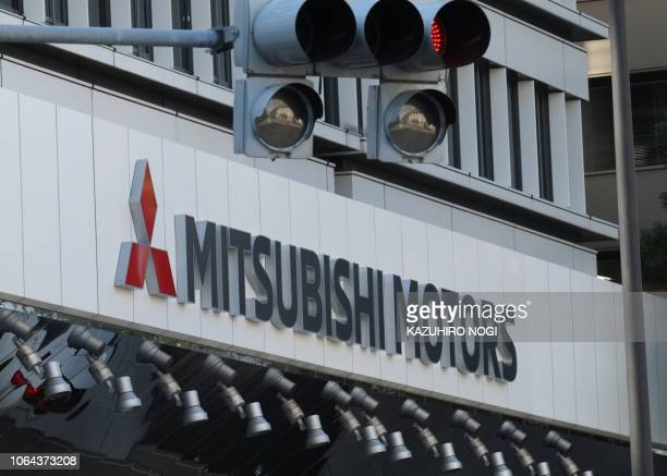 The logo of Mitsubishi Motors is seen at the headquarters of Mitsubishi Motors in Tokyo on November 23, 2018. - Nissan's board sacked Carlos Ghosn as...