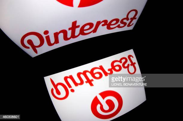The logo of mobile app Pinterest is displayed on a tablet on January 2 2014 in Paris AFP PHOTO / LIONEL BONAVENTURE