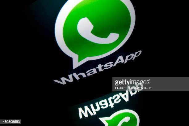 The logo of mobile app 'WhatsApp' is displayed on a tablet on January 2 2014 in Paris AFP PHOTO / LIONEL BONAVENTURE