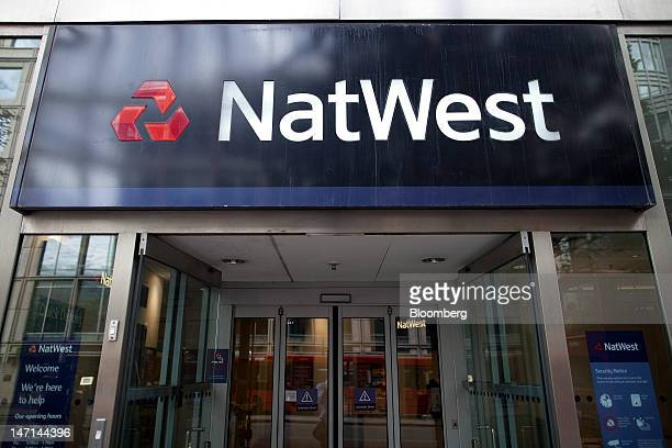 The logo of NatWest a retail unit of Royal Bank of Scotland Group Plc hangs on display outside a bank branch in London UK on Tuesday June 26 2012...