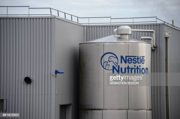 The logo of Nestlé is pictured outside the baby food production plant in Arches on May 11 2017 / AFP PHOTO / Sebastien Bozon