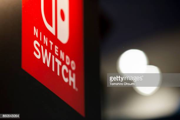 The logo of Nintendo Co.'s Switch video game console is displayed in the Capcom Co. Booth during the Tokyo Game Show 2017 at Makuhari Messe on...