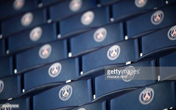 The logo of Paris SaintGermain's football club is seen on seats prior to the UEFA Champions League Group A football match between ParisSaintGermain...