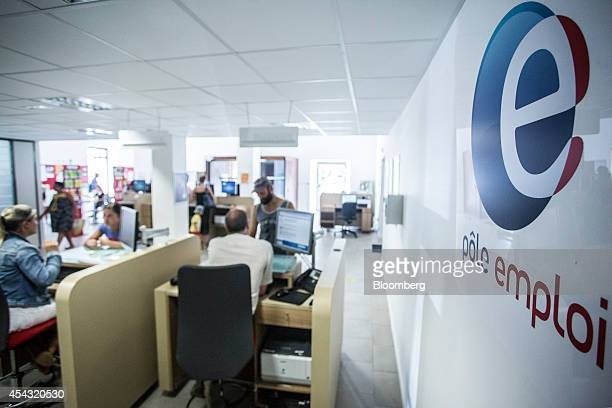 The logo of Pole Emploi the French national employment agency sits on display inside a job center in Cahors France on Thursday Aug 28 2014 French...