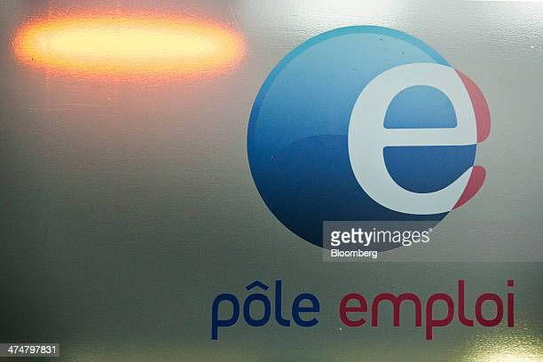 The logo of Pole Emploi the French national employment agency sits on a window of a job center in Montpellier France on Tuesday Feb 25 2014 The...