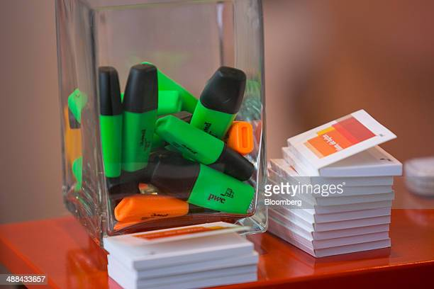 The logo of Pricewaterhouse Coopers International Ltd sits on highlighter marker pens on the accountancy company's stand at the Connecticum job fair...
