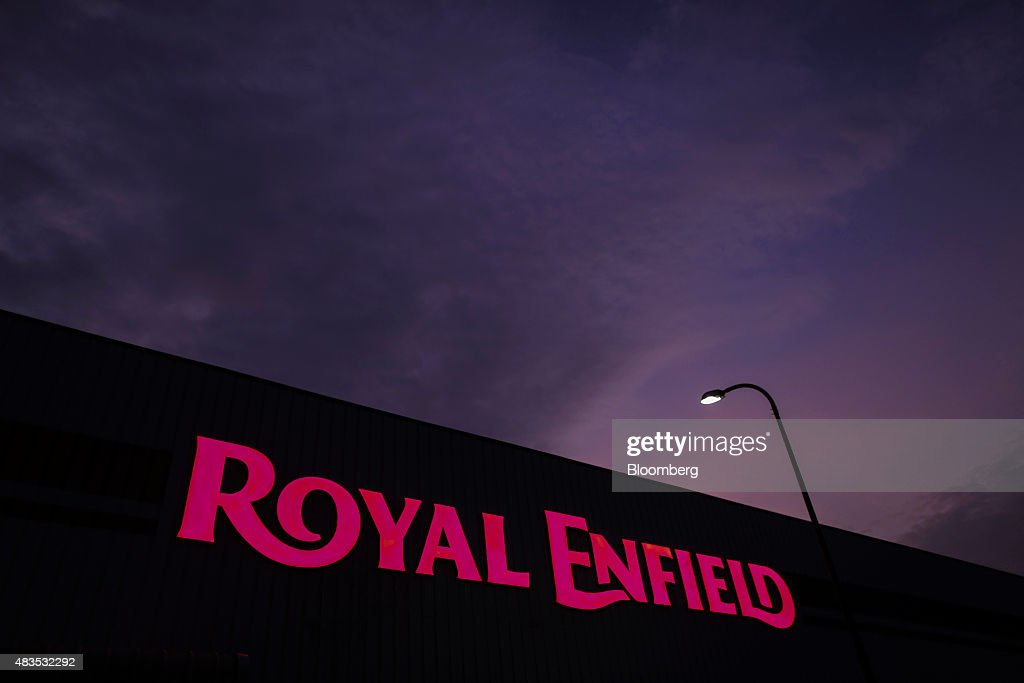 The logo of Royal Enfield Motors Ltd is seen atop the company`s manufacturing facility in Chennai India on Tuesday July 14 2015 In a sweltering...