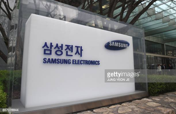 The logo of Samsung Electronics is displayed outside a company's building in Seoul on March 24 2017 The world's biggest smartphone maker Samsung...
