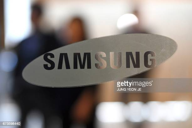 The logo of Samsung Electronics is seen on a glass door at the company's showroom in Seoul on April 27 2017 South Korean tech giant Samsung...