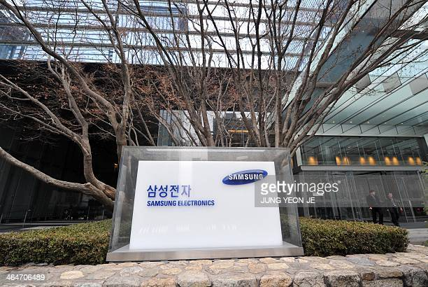 The logo of Samsung Electronics is seen outside of the company's headquarters in Seoul on January 24 2014 South Korea's Samsung posted an 18 percent...