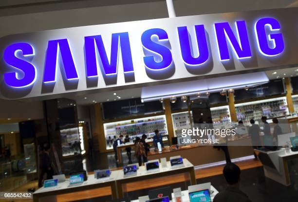 The logo of Samsung is seen at a Samsung showroom in Seoul on April 7 2017 Samsung Electronics said on April 7 it expects profits to soar by 482...