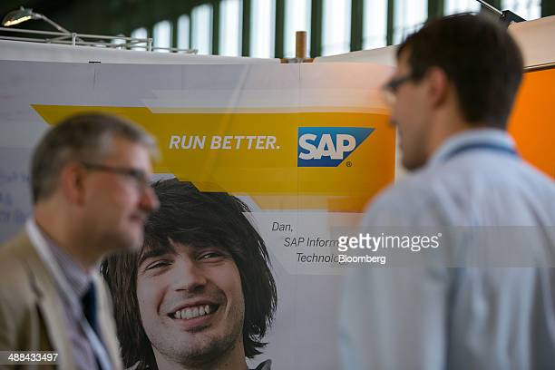 The logo of SAP AG sits on a sign on the software company's stand at the Connecticum job fair for students graduates and young professionals at...