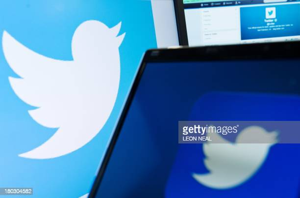 The logo of social networking website 'Twitter' is displayed on a computer screen in London on September 11 2013 AFP PHOTO / LEON NEAL / AFP / Leon...