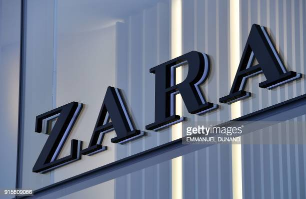 The logo of Spanish clothing retailer chain Zara is on display on the facade of a store in Brussels, on February 8, 2018. / AFP PHOTO / Emmanuel...