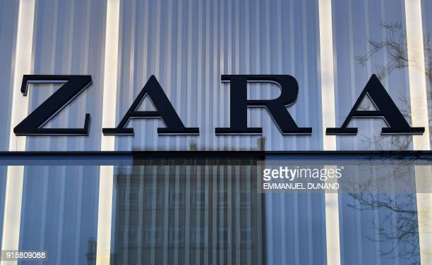 The logo of Spanish clothing retailer chain Zara is on display on the facade of a store in Brussels on February 8 2018