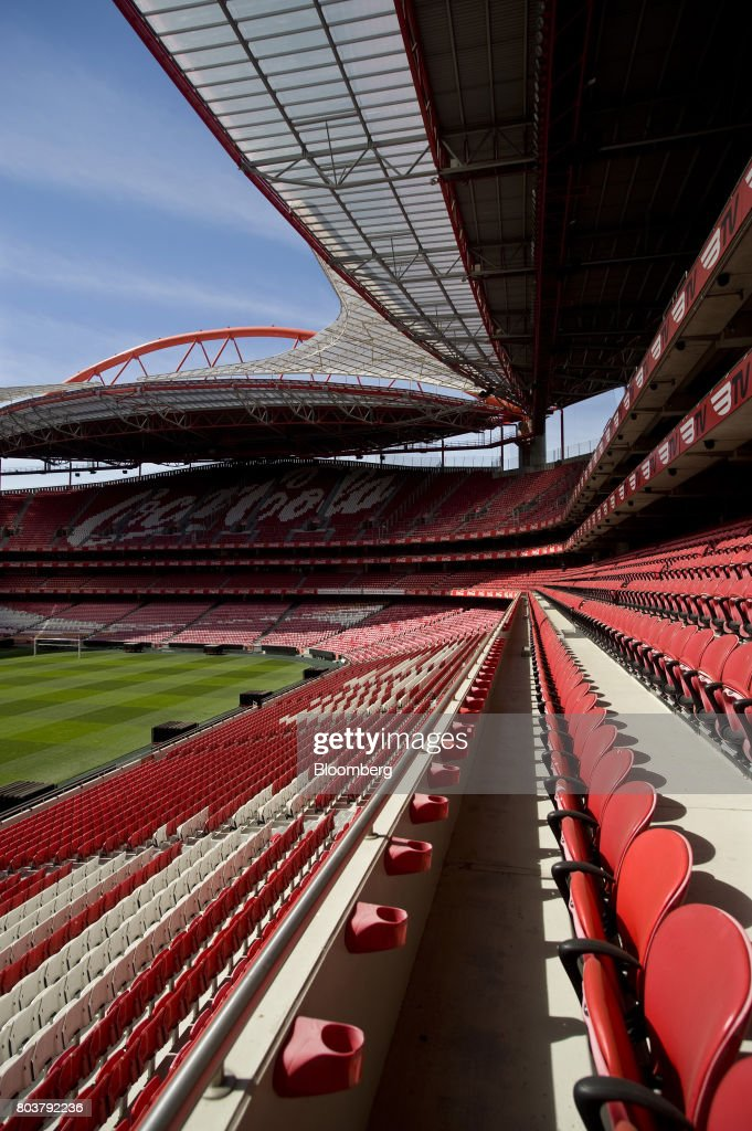 The logo of sponsors Coca-Cola Co. sits on audience seating at the Sport Lisboa e Benfica Luz stadium in Lisbon, Portugal, on Thursday, April 27, 2017. Portuguese teams breed athletes for the most lucrative leagues in the worlds richest sport and it gives the nation of 10 million with limited domestic income from television rights and merchandising a slice of global soccers riches. Photographer: Paulo Duarte/Bloomberg via Getty Images