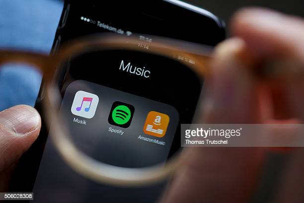 The Logo of streeming services Amazon Music and Spotify is displayed on the screen of a smartphone on January 21 2016 in Berlin Germany
