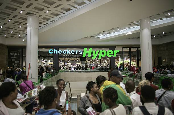 The logo of supermarket chain Checkers Hyper is seen as ...
