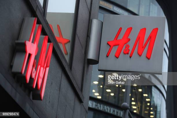 The logo of Swedish clothing retailer HM hangs over one of its stores on March 28 2018 in Berlin Germany HM which is the world's second largest...